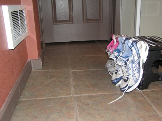 Trying to dry our shoes in front of the air vent :-P